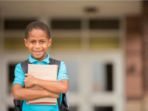 young boy ready for school - istock image