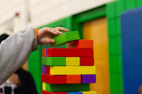 child playing with colorful blocks